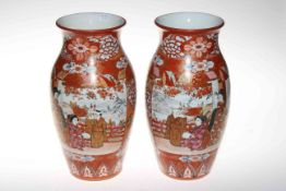Pair large Japanese vases painted with scene of three figures on terrace and profuse foliage,