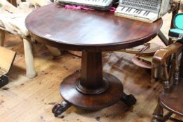 Victorian mahogany circular snap top breakfast table on octagonal tapering pedestal and claw feet,