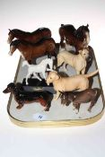 Three Beswick horses, foal, donkey and three dogs.