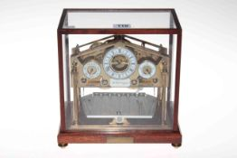 A 20th Century gilt Congreve rolling ball platform clock with main dial flanked by two subsidiary