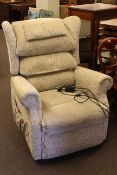 Sherborne rise and fall electric reclining chair in light foliate pattern fabric.