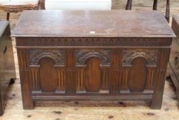 Carved oak triple arched panel front coffer, 62cm by 107cm.