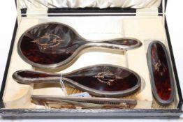 Boxed silver and tortoiseshell brush, mirror and comb set.