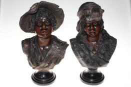 Pair of busts of children, mounted on wood plinths, 45cm and 47cm.