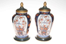 Pair of Imari vases with lids on stands, 35cm.