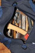 Bag of tools including axes, drill bits, trowel, etc.