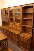 Three section Ercol wall unit and rectangular coffee table.