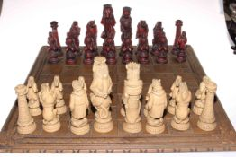 Alice in Wonderland themed chess set with board.