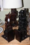 Five pieces of Oriental hardwood including bookends, lamp and figures.