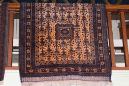 Persian design rug with an orange ground, 2.00 by 1.05.