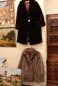 Two ladies fur coats.