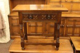 Oak single drawer hall table in turned legs.