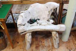 Arboreal hardwood garden seat, 80cm by 82cm.