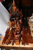 Collection of carved wood animals, tribal spoons and forks, statues, etc.