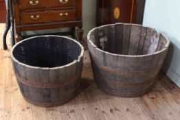 Two 1/2 barrel garden planters, 48cm by 76cm and 43cm by 65cm.