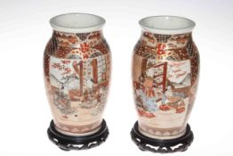 Pair Satsuma vases on carved wood stands, 27cm.