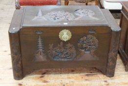 Carved Eastern camphorwood trunk with bowed ends, 57cm by 101cm.