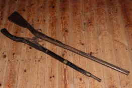 Two rustic flintlock musket guns, 101cm and 124cm.