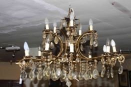 Good two tier fifteen branch ornate gilt metal chandelier with crystal glass drops.