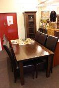 Contemporary hardwood eight piece dining suite comprising slim glazed door cabinet,