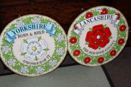 Two circular signs, Yorkshire and Lancashire.