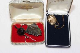9 carat gold locket and chain, 9 carat gold bar brooch and silver peacock feather brooch (3).