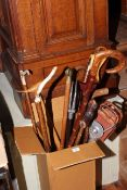 Collection of walking sticks, shooting sticks, two wood boxes, silver plate tureen,