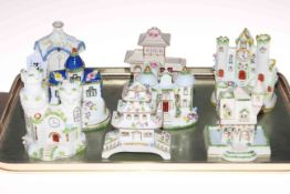 Collection of eight Coalport cottages.