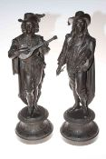 Pair of spelter figures depicting men playing musical instruments, 53cm in height.