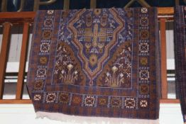 Persian design rug with a blue ground, 2.10 by 1.05.