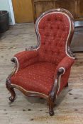 Victorian style mahogany framed gents chair in buttoned fabric.