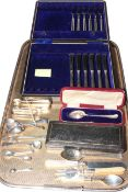 Six silver handled knives and forks, six silver coffee spoons, two pairs of sugar tongs,