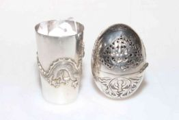 Chinese silver beaker with dragon decoration and a pierced silver egg (2).