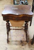 Victorian walnut fold top games table of serpentine form having frieze drawer above a tapering deep