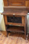 Arts & Crafts oak side table with fall front painted panel door below, 70cm by 61cm.