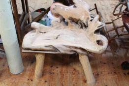 Arboreal hardwood garden seat, 77cm by 77cm.
