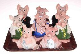 Eight Wade Nat West piggy banks.