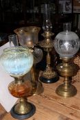 Collection of four late Victorian oil lamps including good vaseline shade.