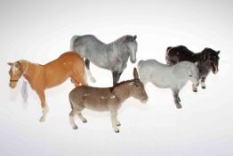 Two Beswick horses, two ponies and a donkey.