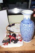 Large blue and white vase, large Coalport plate, damask napkins and three dolls.
