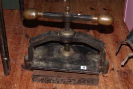 Cast iron book press with brass handles (plate 38cm by 26cm).