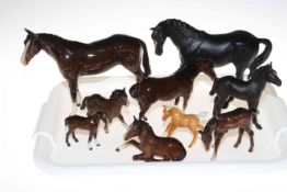 Collection of nine Beswick horses and foals.