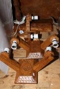 Three Yorkshire carved oak twin wall lights and a Martin 'Lizardman' Dutton carved oak table lamp