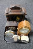A tray of inlaid mahogany and walnut eight day mantel clock, mid century alarm clocks,