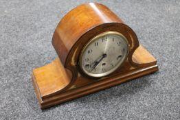 An inlaid mahogany mantel clock