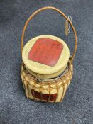 A wicker bound middle eastern style storage container