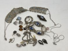 A collection of silver jewellery, enamelled brooch,