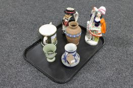 A tray of flat backed Staffordshire figure highland dancer, Mr Pickwick Toby jug,