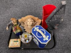 A tray of carved tribal figure, champagne bucket, vintage tin, glass perfume bottle,