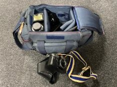 A camera bag containing Olympus OM10 camera,